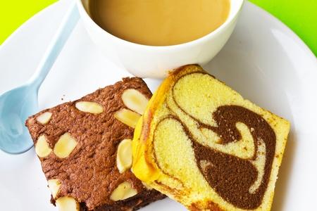 banana bread: Stock Photo - coffee and banana bread isolated on green background