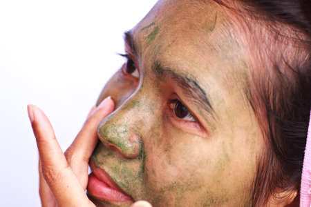Stock Photo - Spa Mud Mask on the womans face photo