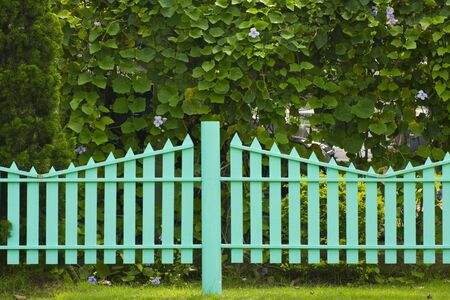Stock Photo - wooden fence in the grass.