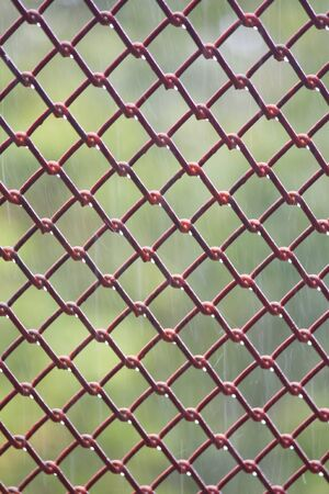 Metal mesh with blur Raining background photo