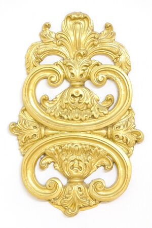 Stock Photo - of an ancient gold ornament on a white background photo