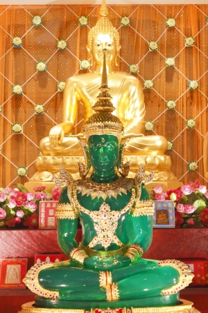 Stock Photo - The Emerald Buddha Mock and gold