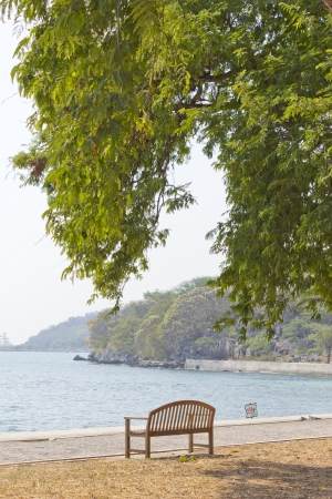Stock Photo - wooden garden chair in beside the sea photo