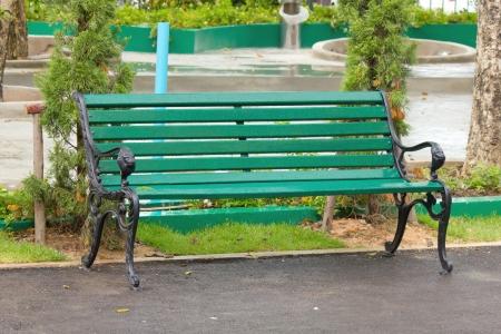 metal garden chair in beautiful garden photo