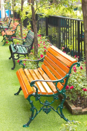 metal garden chair in beautiful garden photo