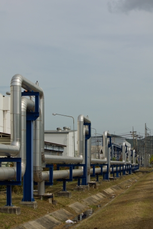 shinereflection: Stock Photo - Industrial zone, Steel pipelines and valves against blue sky Stock Photo