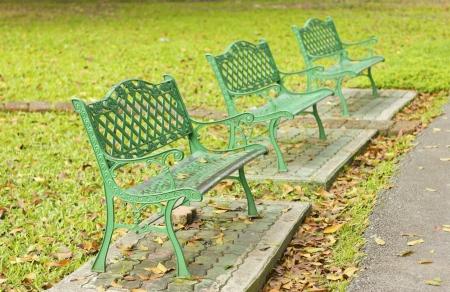 Stock Photo - metal garden chair in beautiful garden photo