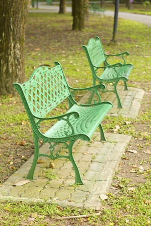 Stock Photo - metal garden chair in beautiful garden photo