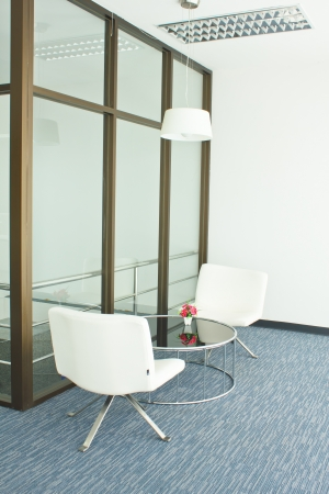 Stock Photo - office building with furniture and a white wall