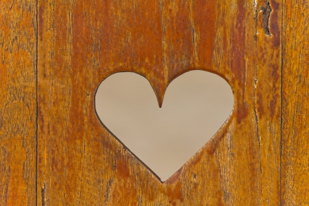 red  plaid: Stock Photo - Heart on the wood.
