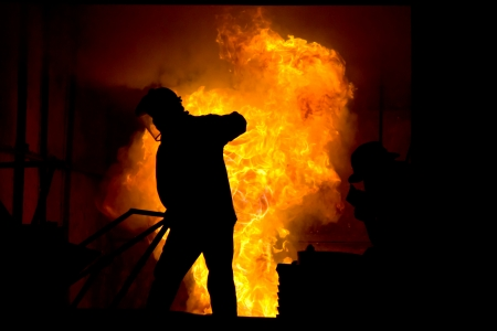 Stock Photo - Hard work in a foundry, melting iron