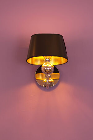 Modern ceiling lamp in a new home photo