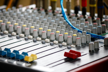 Stock Photo - Sound mixer, low angle shot with shallow DOF, useful for various music and sound themes photo