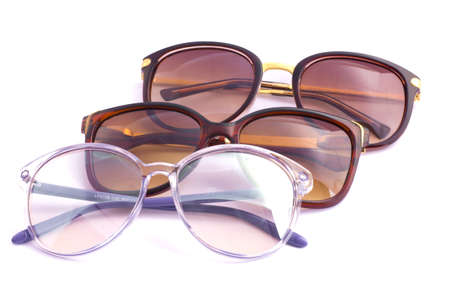 Assorted styles of tinted sunglasses isolated on white background  photo