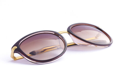 Brown sunglasses on isolated white background - Stock Photo photo
