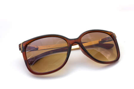 Brown sunglasses on isolated white background  photo