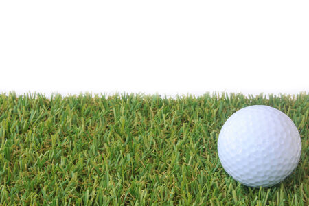 Stock Photo - isolated golf ball on green grass over white background photo