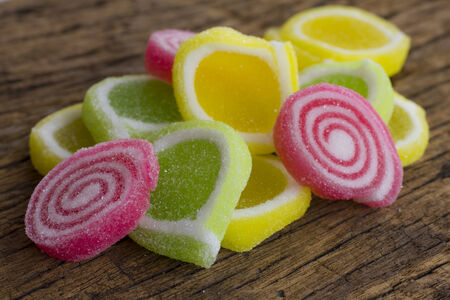 Stock Photo - Colorful candy on a wood background  photo