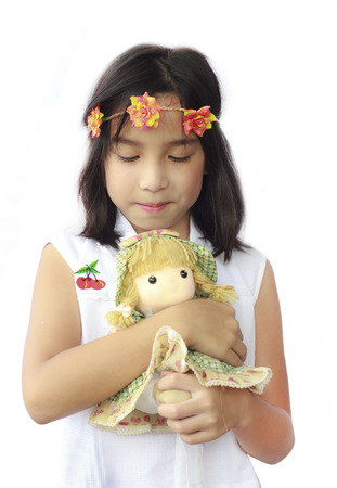 Stock Photo - Asia little girl with doll photo