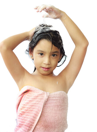 shampooing: Asian  girl shampooing her hair