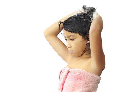 shampooing: Asian  girl shampooing her hair Stock Photo