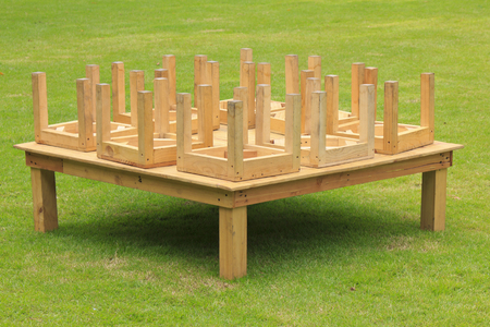 wooden table in park on a sunny day Stock Photo photo