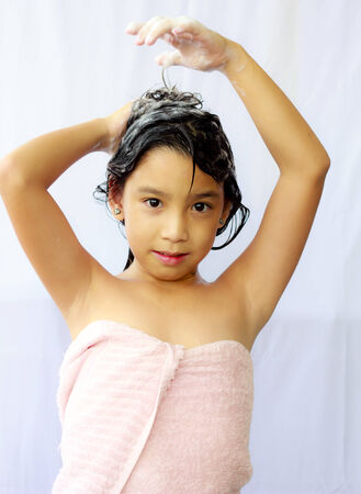 shampooing: Stock Photo - asian  girl shampooing her hair