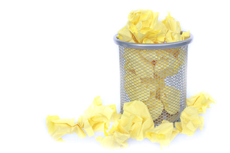 trashed: trashcan full of crumpled paper  Stock Photo