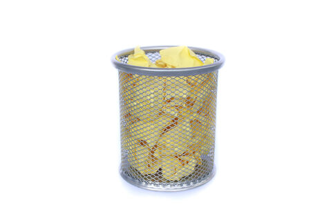 wastepaper basket: trashcan full of crumpled paper  Stock Photo