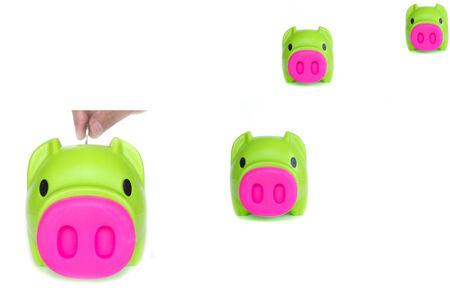 frugality: green Piggybank on Isolated White Background - Stock Image