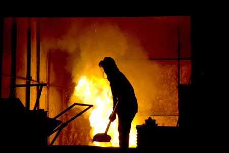 Stock Photo - Hard work in a foundry, melting iron photo