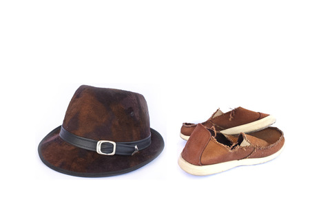 Leather caps and old red sneakers on white Stock Photo photo