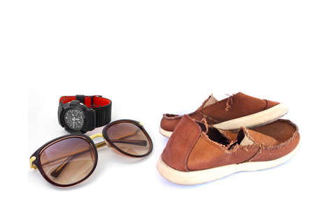 Sunglasses and old red sneakers on white Stock Photo photo