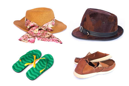 Womens and mens hats ,slippers and old red sneakers on wihte photo