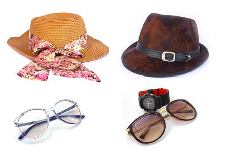 Womens and mens hats and Brown sunglasses on wihte photo