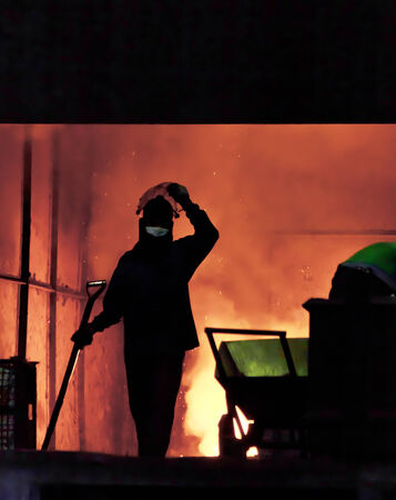 steel worker: steel worker takes a sample from oven Stock Photo