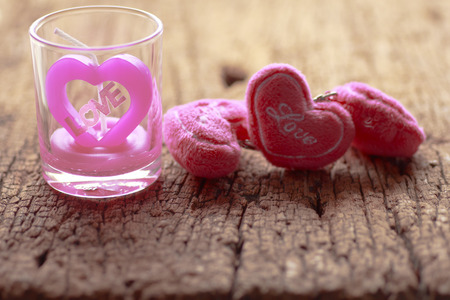 St Valentines day greeting card with candle and hearts on wood black background photo