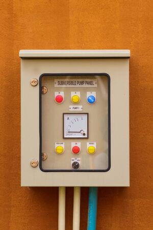 volt: electric control box and volt gauge panel Stock Photo