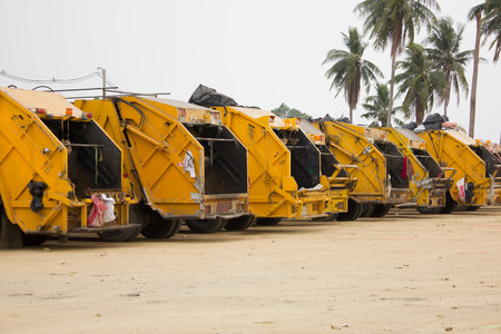 Yellow garbage truck service in the city
