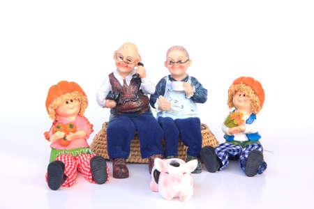 grandkids: Portrait of happy grandparents with their grandchildren sitting outdoors Stock Photo