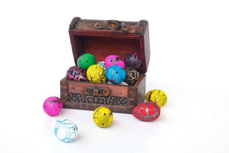 colorful chocolate eggs - four eggs in front of box photo