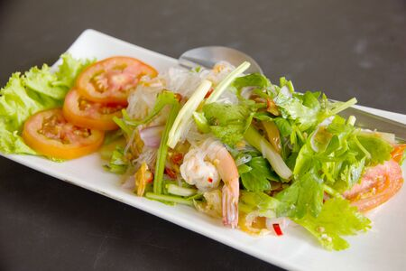 Glass noodle with seafood and vegetables photo