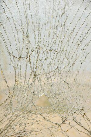 demolish: broken glass - cracked with hole over black Stock Photo