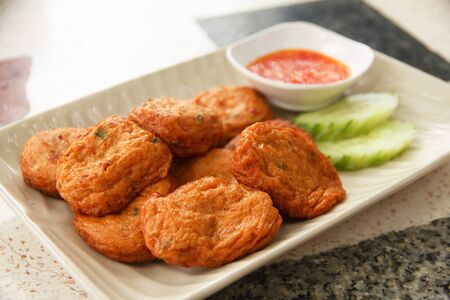 Thai Food Fried Fish Cake with sweet and sour sauce.