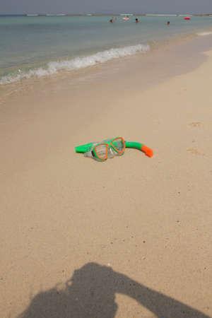 deepsea: close up of a diving mask on a golden beach