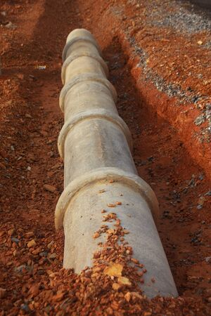 ditch: cement pipeline ditch on the construction site Stock Photo