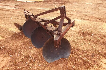 scrap iron: rusty of plow mechanical for tractor agricultural Stock Photo