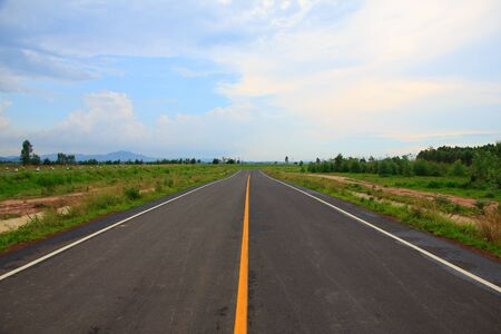 Straight roadway in a sunny day