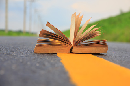 Open book on road outdoors