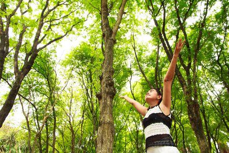 exhilaration: Woman enjoying in the park Stock Photo